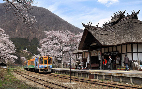 Aizu Railway's Yunokami-Onsen Station in Fukushima Prefecture. The station has a footbath onsen, hot spring, and a sunken fireplace making it popular amongst railway enthusiasts. Image: Wikipedia.