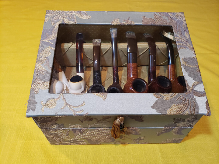 Pipe collection in a special handmade Japanese-style case belonging to a Japanese Sherlock Holmes fan, Hiroshi Minemura. A senior publishing executive at a major international publisher who as a child was determined to learn and master English with the aim of reading the original Sherlock Holmes tales, he enjoyed reading so much in Japanese, in English. A decision that changed his life and took him on his own international publishing adventures in London, San Francisco, Brussels and Amsterdam. Photograph: Hiroshi Minemura